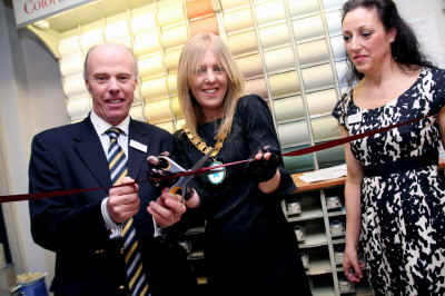 Kevin O'Connor and Cllr. Bevan cut the ribbon - watched by Sarah Kennedy