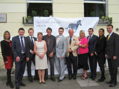 Cheltenham office Investec staff with new banner