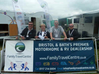 Raine & the Team from the Family Travel Centre stand