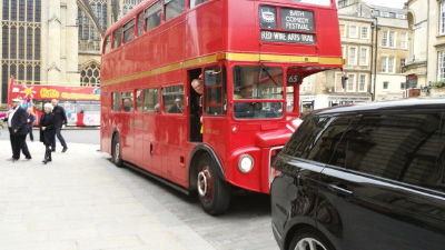 Guests arrive on the Red Bus with Lorraine Chase as the conductress